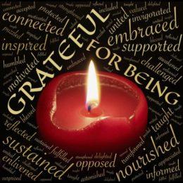 Red candle burning surrounded by words of gratitude (image courtesy of johnhain (pixabay.com)